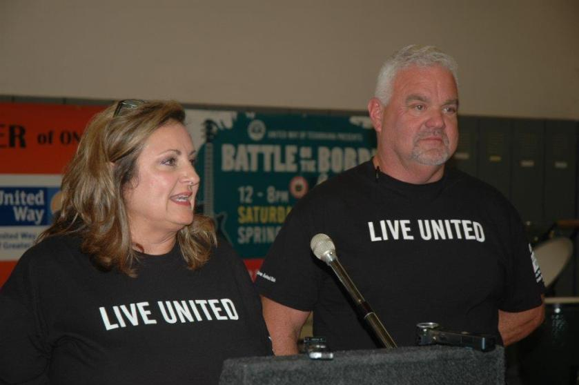 United Way co chairs at podium 1